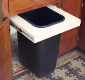 kitchen island with garbage bin